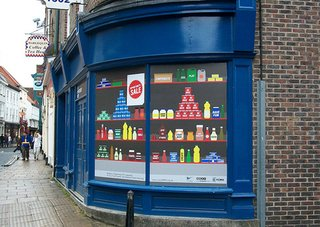 Windows of Opportunity in UK - Photo 1 of 5 - 'Retro Shop' by Vorm Studio evokes the nostalgia of a traditional 1950s shop featuring objects with positive names, such as 'Have Fun,' 'Share,' and 'Relax.' (See leading photo.)