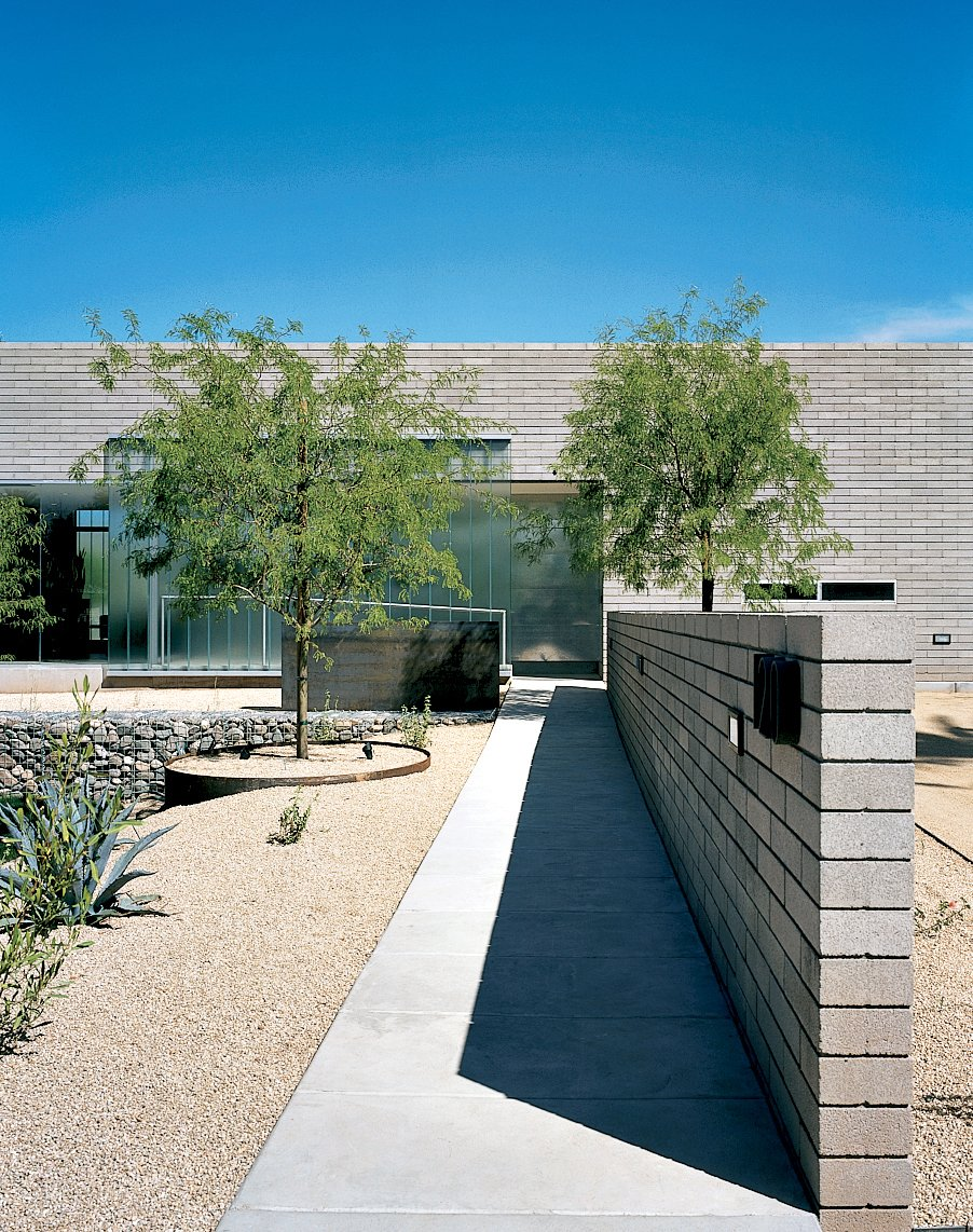 The DeBartolos wanted to keep the desert tradition of incorporating water near the entrance of the house as a sort of welcome mat, but they skipped the faux hacienda   fountain found throughout Arizona in favor of twin sheets of four-by-eight-foot steel plates that water pours over. Making the unusual fountain from standard-sized materials, which will weather naturally over the years, kept the cost down, too.  Photo 6 of 23 in 20 Desert Homes