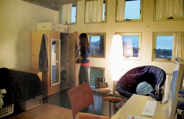 "One of the more spacious singles, Amanda's room has a 3 x 4 array of windows that look out into Boston. ""Thank goodness I don't have a curvy wall anymore,"" says Amanda."