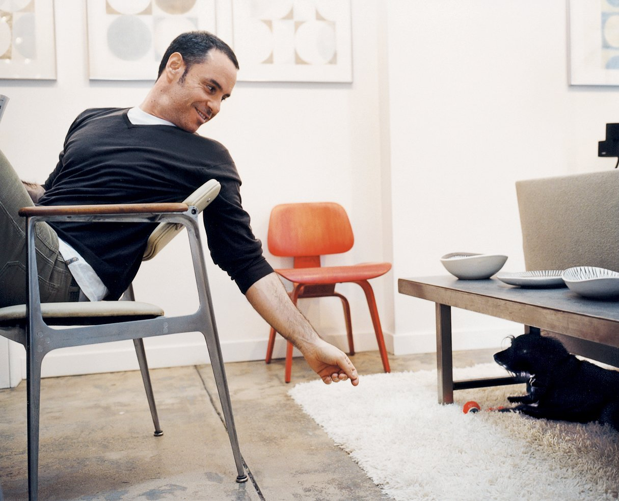 Weinstein checks in with Spencer the dog in the residence.  Photo 3 of 6 in A Mid-Century Manhattan Loft