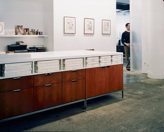 A Mid-Century Manhattan Loft - Photo 6 of 6 - Florence Knoll credenzas, with laminate tops designed by the architects, form a unique work station in the office.