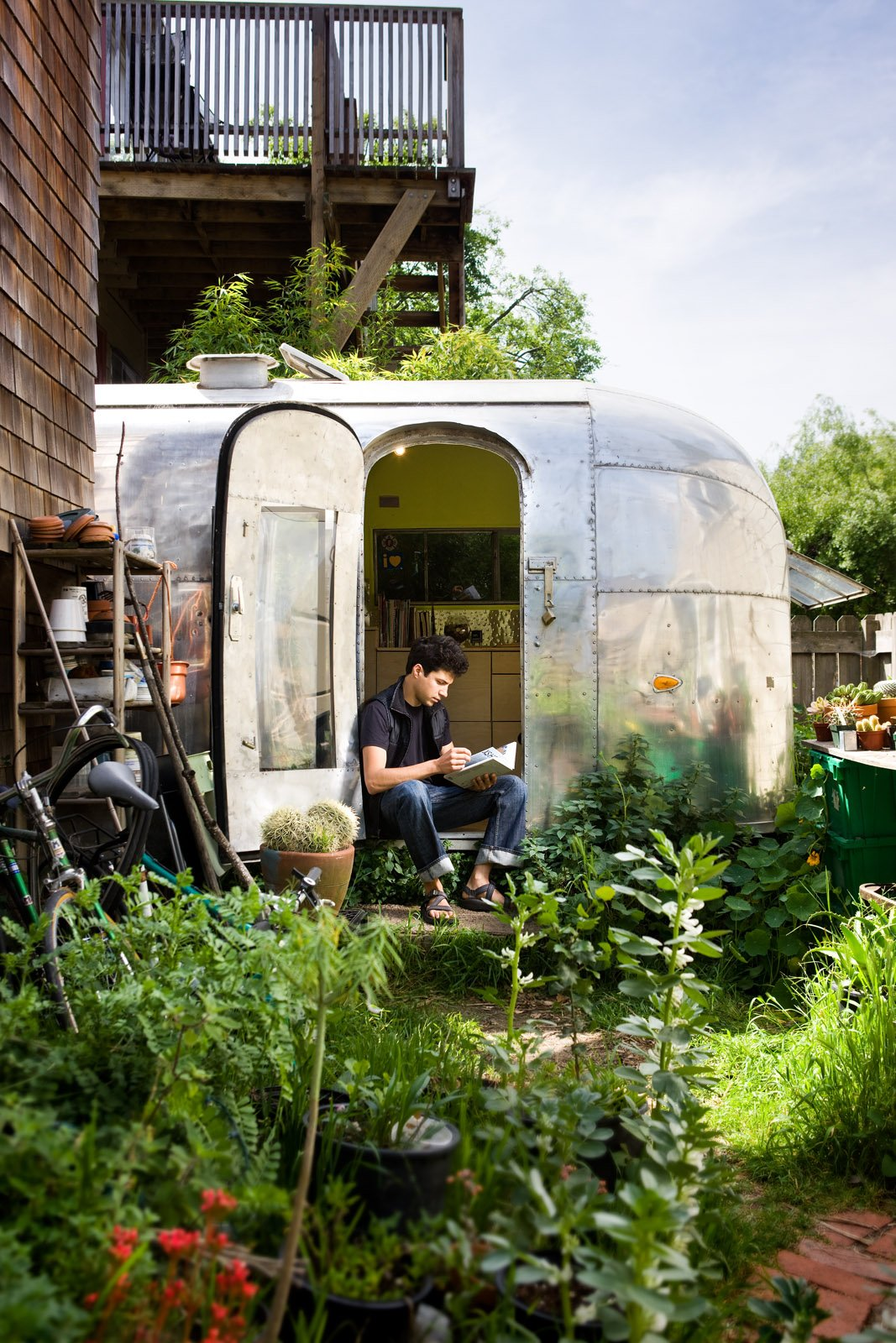 The Airstream is tucked into the back garden of a Berkeley co-op.  Having a garden at my footsteps and chickens just over the fence make it feel peaceful and private. Tagged: Exterior, Airstream Building Type, Metal Siding Material, and Metal Roof Material.  Photo 4 of 8 in The Airstream Life