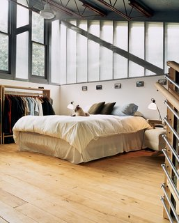 No alarm clock needed here. The highest point in the house is the bedroom, bathed in light from two walls made predominantly of windows and a third completely open to the rest of the house.