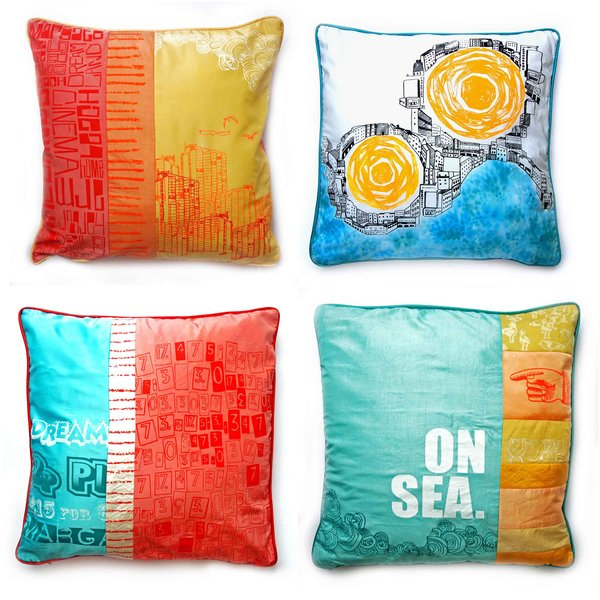 A collection of pillows created from reclaimed silk from old dresses and screened with Murphy's seaside-inspired designs.