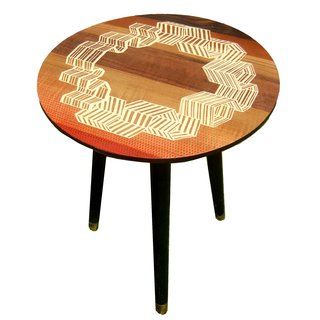 The Windbreaker Table, with a hand-veneered design of seaside windbreakers situated in a circle formation.
