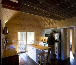Farmhouse Redux - Photo 5 of 13 - The kitchen, totaling an affordable $5,000 for all fixtures, refrigerator, stove, etc., came from Ikea. Image courtesy Chad Everhart Architect.