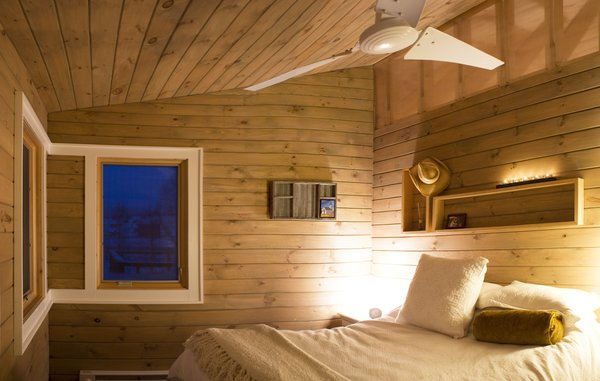 The corner window in the bedroom frames the view of one of three creeks and streams surrounding the two-and-a-half-acre site. Image courtesy Chad Everhart Architect.