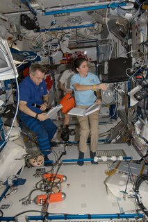 Space Living: Astro Home - Photo 4 of 32 - Canadian Space Agency astronaut Robert Thirsk and NASA astronaut Nicole Stott, both Expedition 21 flight engineers; along with European Space Agency astronaut Frank De Winne (background), commander, work in the Harmony node of the ISS. Photo taken October 15, 2009. Image courtesy of NASA.