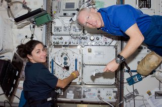 Space Living: Astro Home - Photo 11 of 32 - Astronauts Nicole Stott, Expedition 20 flight engineer; and Patrick Forrester, STS-128 mission specialist, work in the Kibo laboratory of the ISS while Space Shuttle Discovery remains docked to the station. Photo taken August 31, 2009. Image courtesy of NASA.