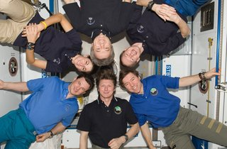 Space Living: Astro Home - Photo 17 of 32 - Expedition 20 crew members pose for an in-flight crew photo in the Harmony node of the ISS. Pictured clockwise are Russian cosmonaut Gennady Padalka (bottom center), commander; Russian cosmonaut Roman Romanenko, NASA astronaut Nicole Stott, Canadian Space Agency astronaut Robert Thirsk, European Space Agency astronaut Frank De Winne and NASA astronaut Michael Barratt, all flight engineers. Photo taken October 1, 2009. Image courtesy of NASA.