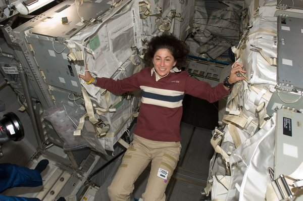 NASA astronaut Nicole Stott, Expedition 20 flight engineer, is pictured in the Leonardo Multi-Purpose Logistics Module (MPLM), temporarily attached to the ISS while Space Shuttle Discovery (STS-128) remains docked with the station. Photo taken September 5, 2009. Image courtesy of NASA.