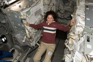 Space Living: Astro Home - Photo 3 of 32 - NASA astronaut Nicole Stott, Expedition 20 flight engineer, is pictured in the Leonardo Multi-Purpose Logistics Module (MPLM), temporarily attached to the ISS while Space Shuttle Discovery (STS-128) remains docked with the station. Photo taken September 5, 2009. Image courtesy of NASA.