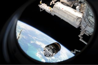 Space Living: Astro Home - Photo 32 of 32 - Backdropped by Earth's horizon and the blackness of space, the unpiloted Japanese H-II Transfer Vehicle (HTV) approaches the ISS. Once the HTV was in range, NASA astronaut Nicole Stott, Canadian Space Agency astronaut Robert Thirsk and European Space Agency astronaut Frank De Winne, all Expedition 20 flight engineers, used the station's robotic arm to grab the cargo craft and attach it to the Earth-facing port of the Harmony node. The attachment was completed at 5:26 (CDT) on Sept. 17, 2009. The Japanese Kibo complex (top right) and the Canadarm2 (bottom right) are also visible in the image. Photo taken September 17, 2009. Image courtesy of NASA.