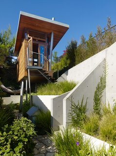 The tree house is perched on a hill that offers canyon vistas and views of downtown L. A. and the Getty Museum.