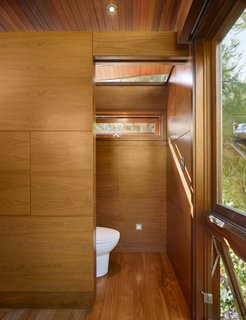 An Atypical Tree House - Photo 6 of 11 - The tree house serves also as temporary guest quarters, with modern-day amenities like a daybed, a sink, a toilet, a small refrigerator, a fireplace and a microwave.