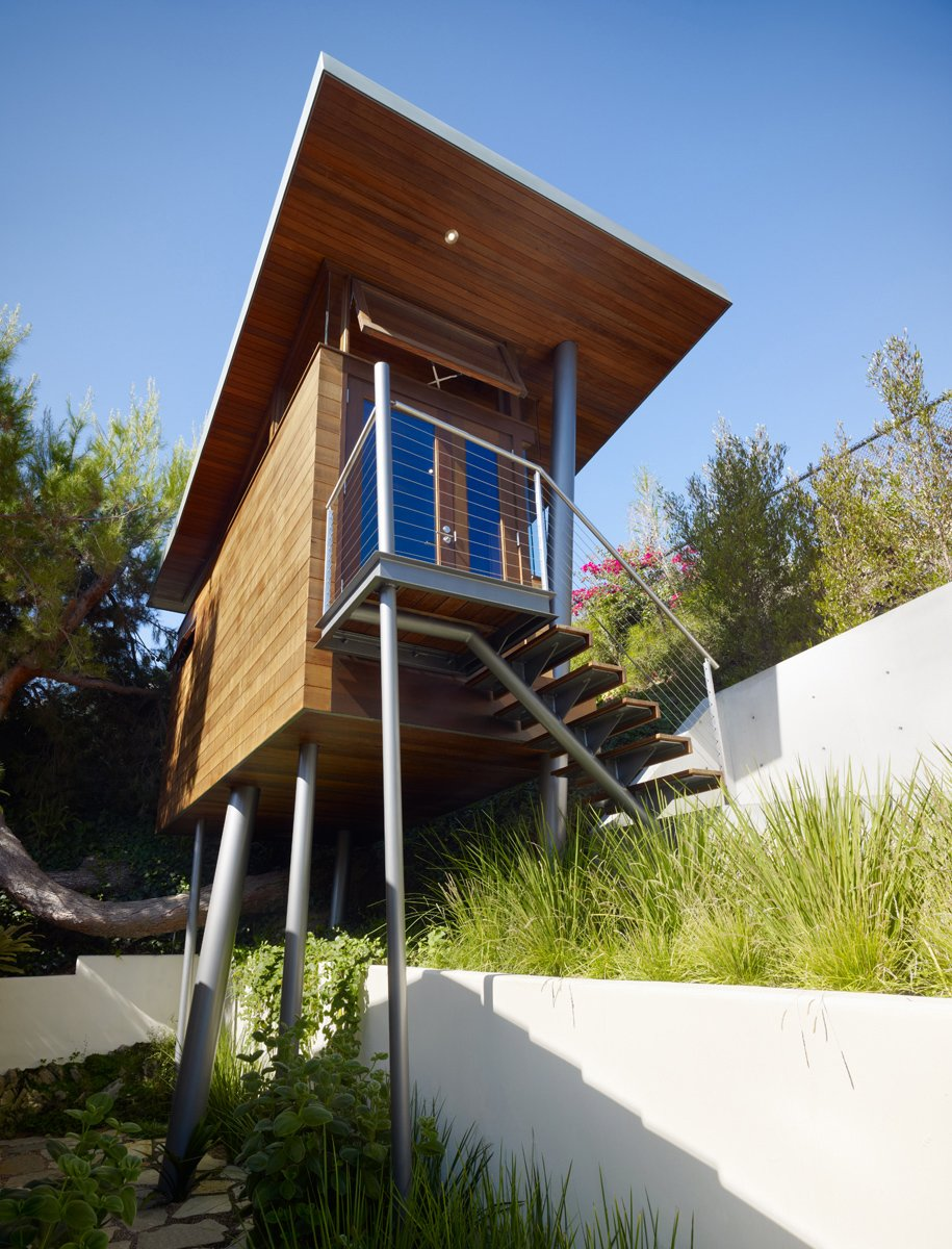"Metaphorically, architect Chris Kempel said, the Kynar-painted steel columns are trees.  ""It was like taking a box and poking it with chopsticks."" Tagged: Exterior, Treehouse Building Type, and Cabin Building Type.  Photo 8 of 11 in An Atypical Tree House"