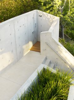 The outdoor shower below the tree house was shaped and formed from concrete to be a truly private experience.