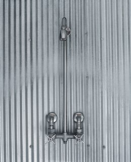 Farm Fresh - Photo 6 of 10 - A simple shower design using corrugated steel references farmhouses of old.