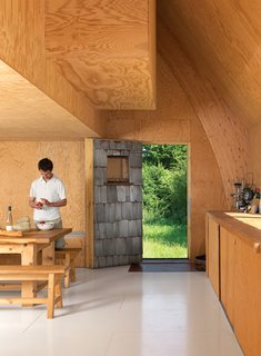 The exposed-wood motif continues inside, where plywood walls, as well as Barache and his guests, keep things warm.