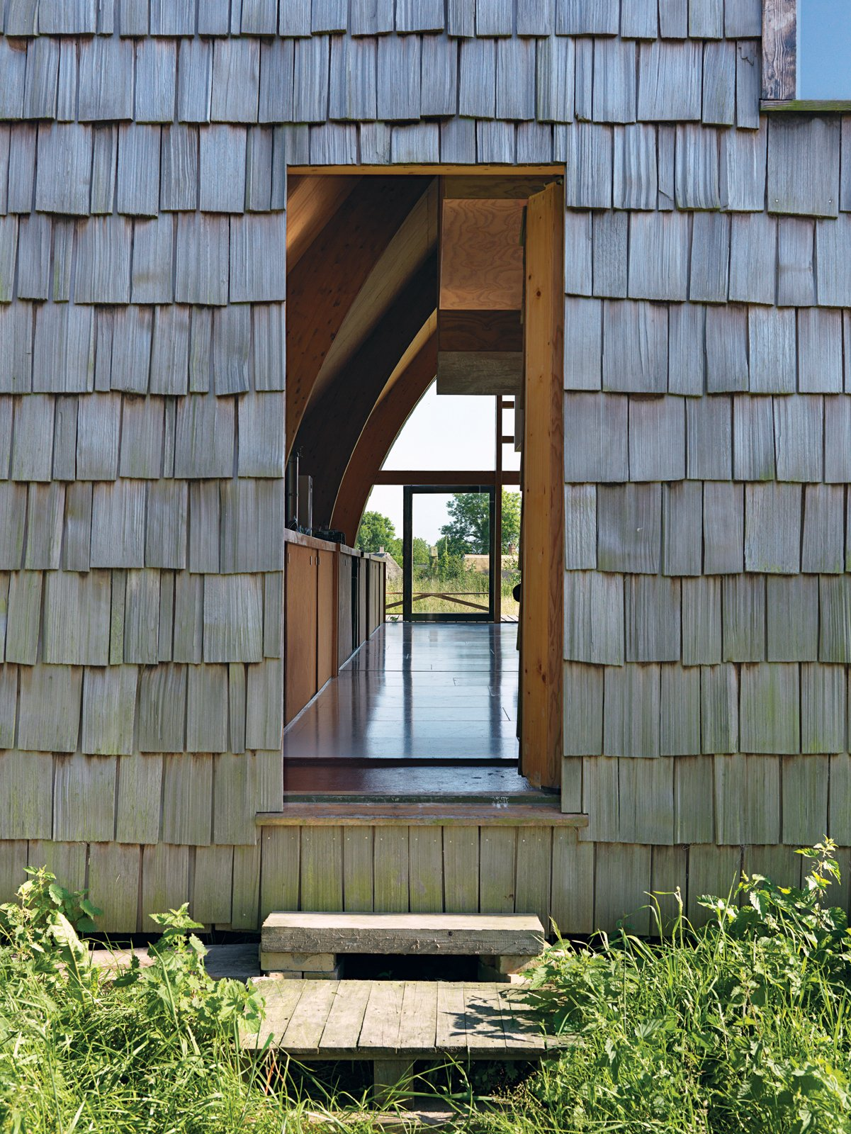 The front door dissolves into the facade.  Photo 11 of 11 in Modern Wooden A-Frame Retreat in France