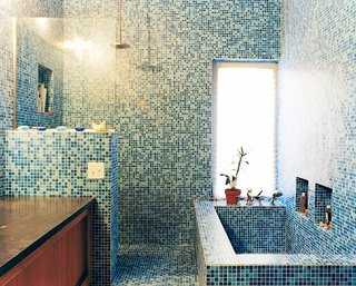 9 Unusual Modern Bathrooms - Photo 6 of 9 - The blue-tiled master bathroom stands in contrast to the muted tones of the rest of the house. The tile is recycled glass from China.