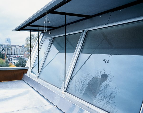 """""""There's nothing fancy about it,"""" explains Mihalyo of how the south-facing second-story window helps to both cool and heat the house. """"It's just good placement of the window with a canopy over it."""""""