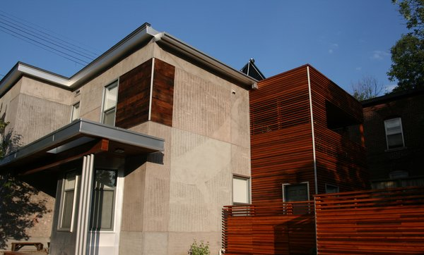 Griffin carved a humpback whale into the west elevation, which he dedicated to the sea. A new, aluminum-framed overhang adds a linear element and plays off of the house's original floorboards employed as accent cladding, near the top.