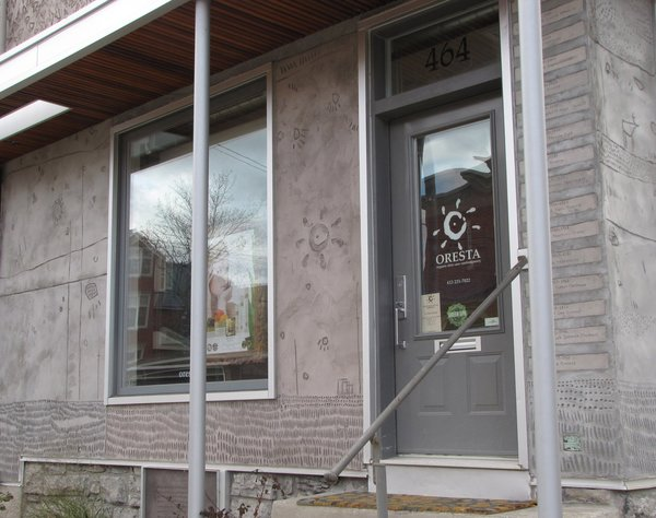 The entrance to Oresta's organic skin care confectionary. To the right of the door is a list of every recorded owner of the businesses the building has housed since the turn of the century, based on the couple's title and historical research.
