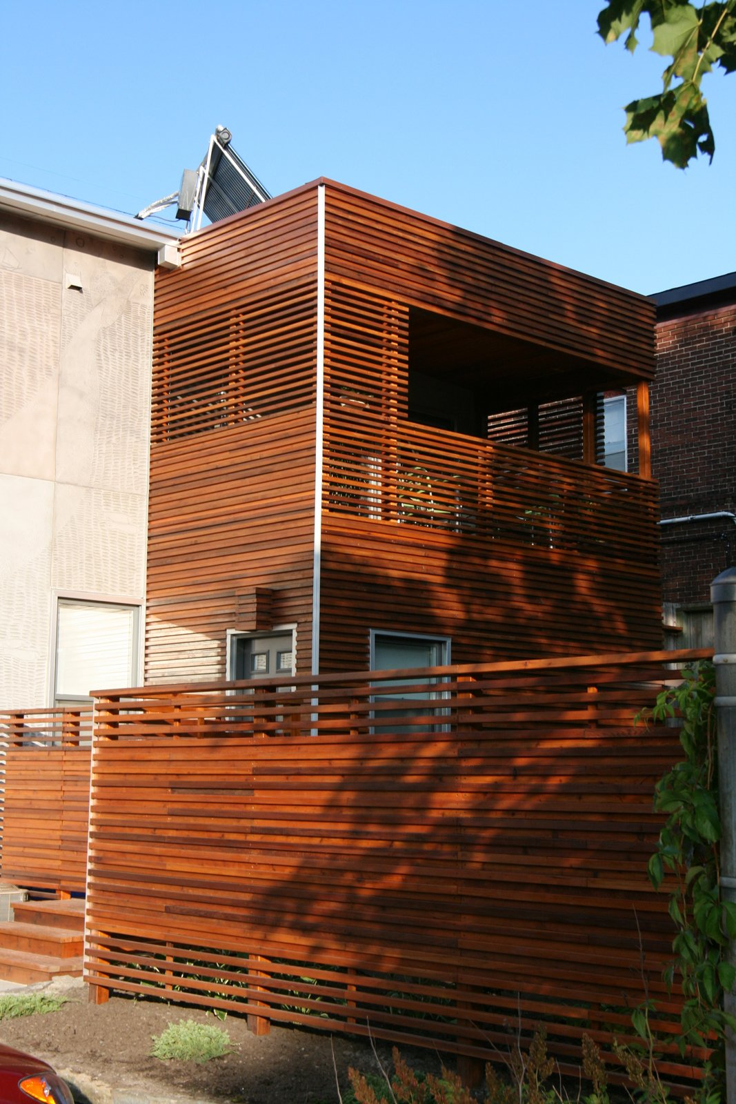 The architect used horizontal slats for privacy, but alternated them on the fence and second-floor deck to allow sunlight and breezes through. Solar panels atop the roof heat the water; a green roof is in the process of growing in. The project was awarded Green Renovation of the Year and Best Housing Detail at the 2009 Ottawa Housing Design Awards.  30+ Best Modern Fences by William Lamb from Engraved House