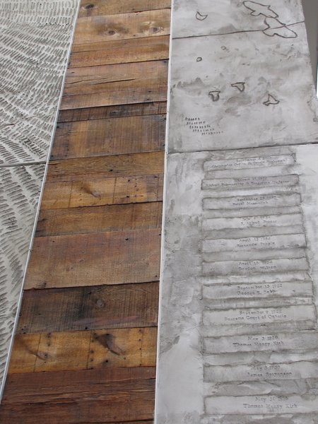 The original floorboards accompany the stamped list of property owners.