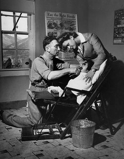 Dentist Making an Extraction. Questa, New Mexico, 1943. By John Collier Jr., image courtesy The American Image.