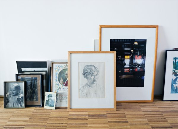 Van Dijk's framed pictures stacked on the floor form an impromptu point of visual interest.