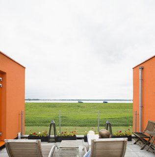 The nearby lake makes for a pretty setting, especially when framed by Villa Van Vijven's orange facade.