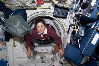 Space Living: Astro Home - Photo 6 of 32 - Bungee cords become your new best friends, as they harness both you and all potentially moving objects to the floors, ceilings, and walls. These elastic workhorses keep Nicole Stott's float through the station from being a literal crash course through its contents. Image courtesy of NASA.