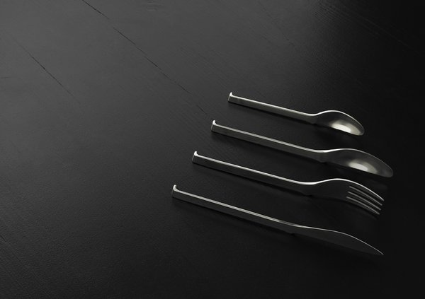"Oki Cutlery by KiBiSi. Designed in 2007 to combine the idea of a chopstick rest (""hashi oki"") with Scandinavian cutlery design so the ends of the forks, spoons, and knives never touch the tabletop. In prototyping phase.brbrPhoto courtesy of KiBiSi"