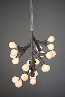 Bunch of Bulbs pendant lamp by KiBiSi. Designed in 2005 with standard plumbing fittings. Limited Edition. <br><br>Photo courtesy of KiBiSi