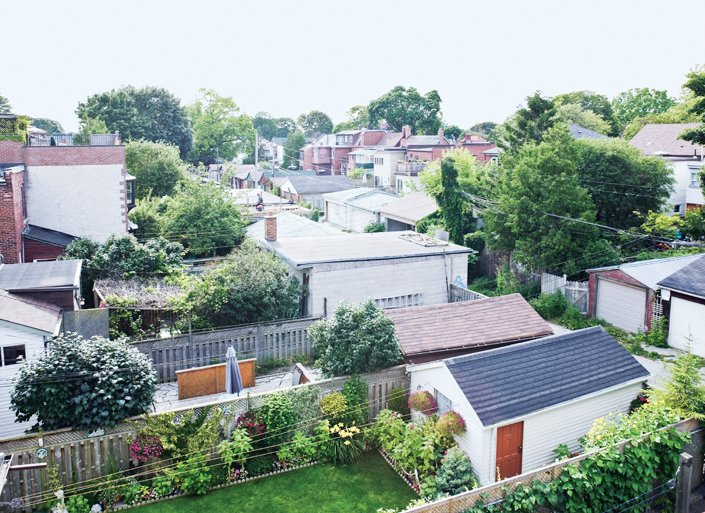 At the top, the view from the roof deck reveals a patchwork of garages and yards surprisingly free of neighbors.  Photo 3 of 18 in Narrow Modernist Three-Story Home in Toronto