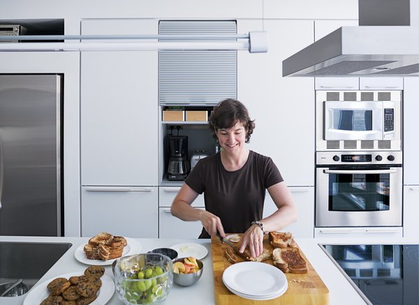 A white Bulthaup system fits cleanly into the 13-foot-long kitchen.