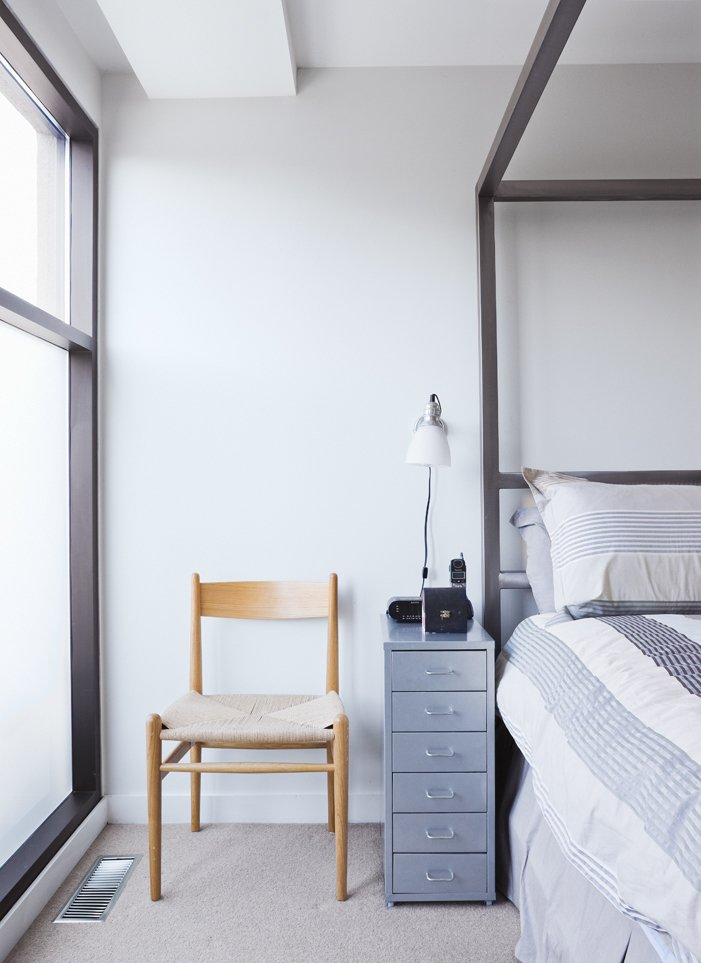 The master bedroom occupies a private space on the top floor.  Bedrooms by Dwell from Narrow Modernist Three-Story Home in Toronto