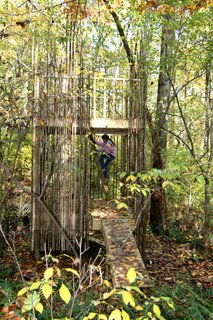 "Baltimore Tree House - Photo 3 of 10 - Scale was an important design factor. ""We wanted it to be flexible,"" Laurie says. ""It's scaled down for a child but is also tall enough so an adult can walk in it."" The height between the floor of the lower platform and its ceiling is six feet—so taller adults do still need to duck slightly, but most can make it through. ""Kids are small for a very short time and then they grow up and go to college and you're left with this structure,"" she says. ""We wanted it to have a use after they're gone."" Pictured here is Laurie and Peter's daughter Emily.Photograph courtesy of Laurie Stubb."