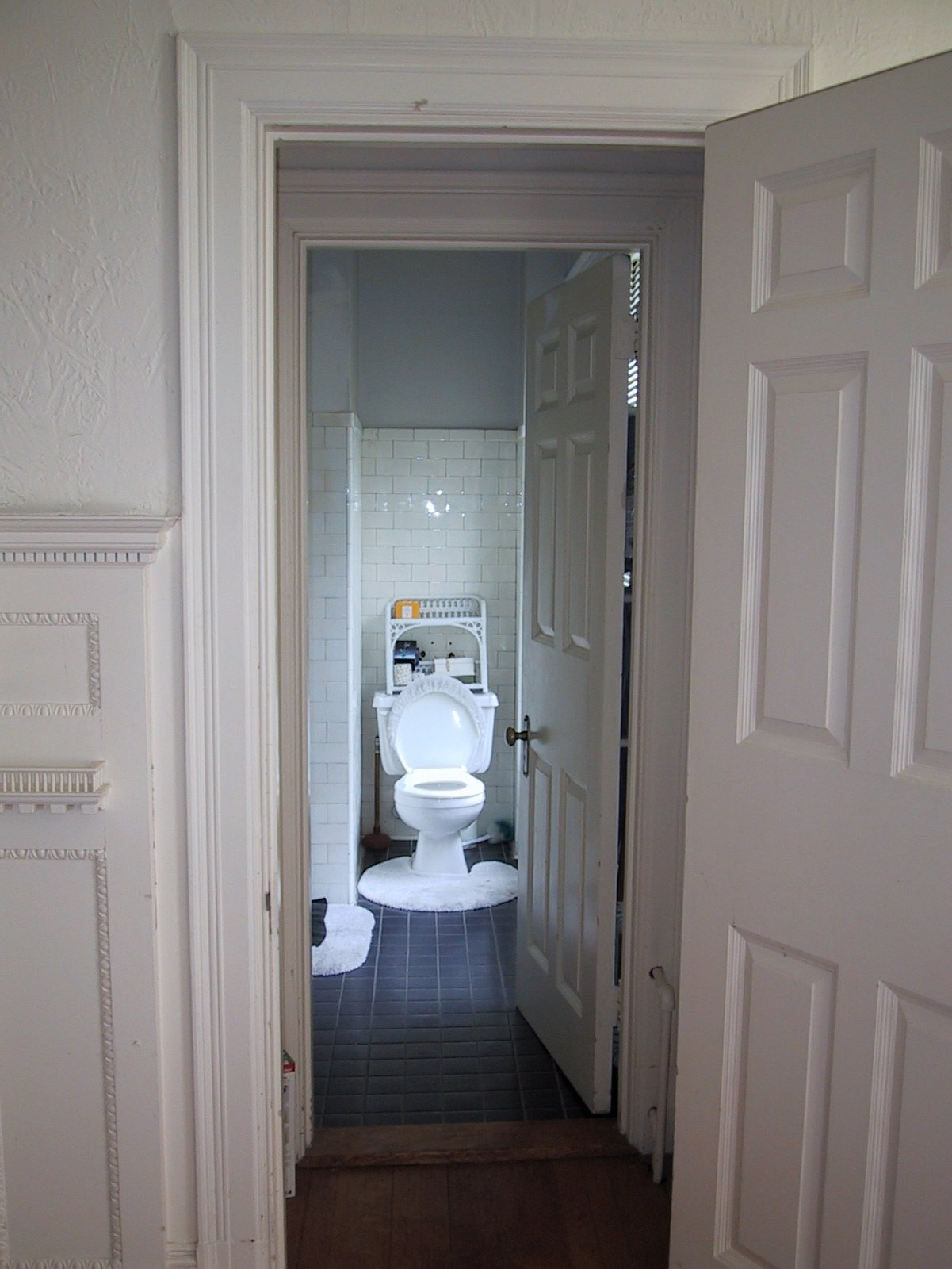 Before the renovation, the bathroom served as both the master bath as well as the powder room, creating unnecessary traffic between the private and public spaces of the house. Butz and Klug found a solution by uniting the master bathroom (which had been separated into two rooms by prior remodels) and adding a guest bathroom. Photo courtesy of   Butz + Klug Architecture  Photo 2 of 4 in Loo & Improved