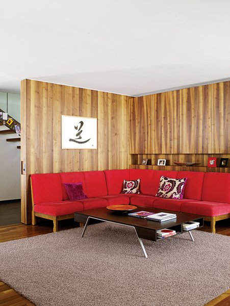 The red sofa in the living room is a 1960s piece originally owned by Strolz's parents.