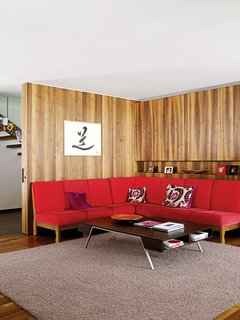 Red, Red, and More Red! 20 Bold Interiors That Make a Statement - Photo 19 of 20 - The red sofa in the living room is a 1960s piece originally owned by Strolz's parents.