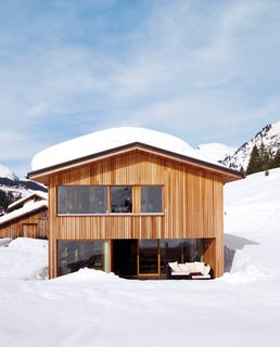 101 Best Modern Cabins - Photo 86 of 101 - The solar panels on the roof often get covered in a heavy layer of snow, but with periodic clearing, they are as effective during the sunny days of winter as they are during fairer weather.