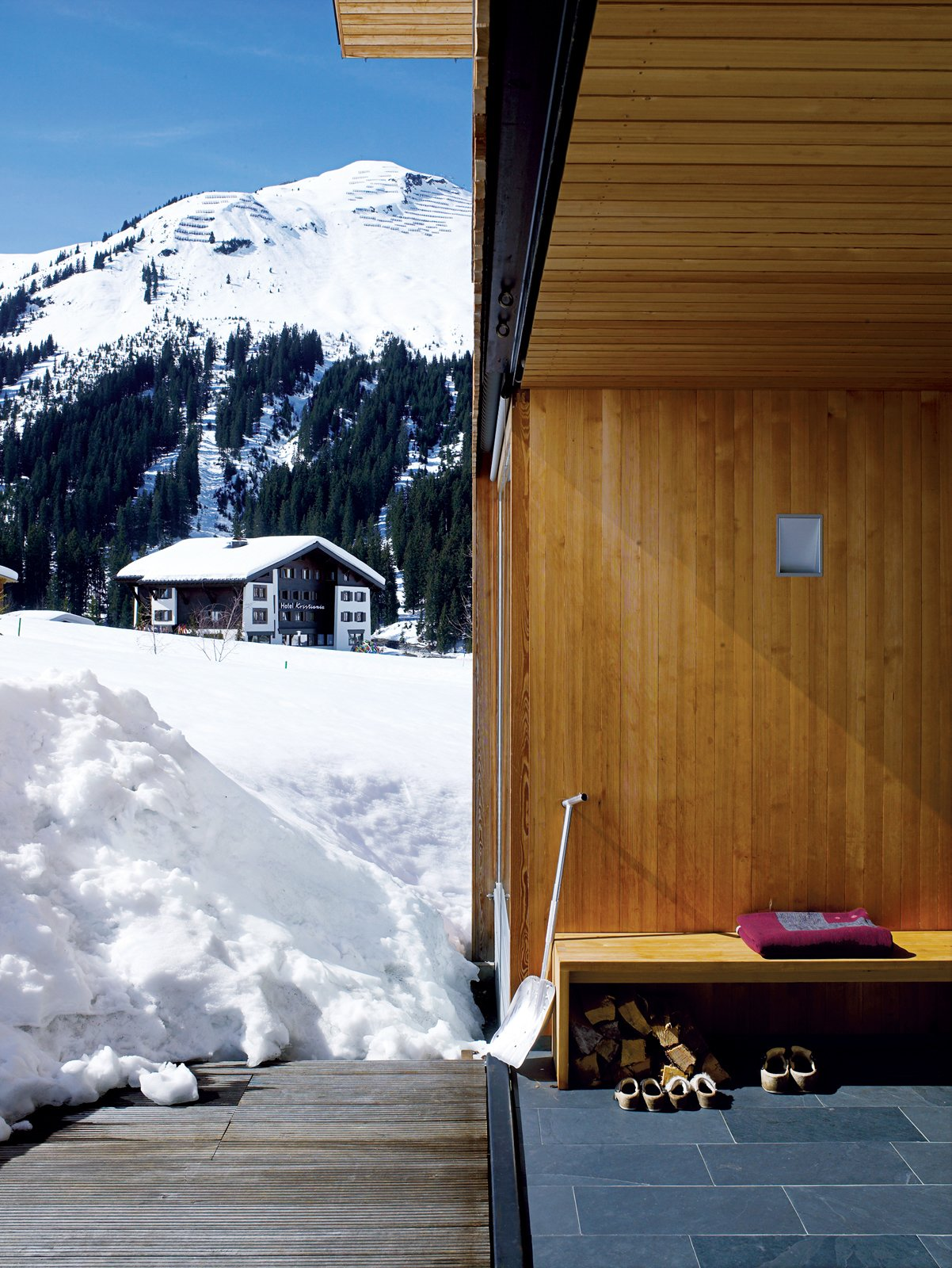 The porch also has its own protective wooden shutter, which rises upwards from a recessed pocket in the floor. Snow Proofed Hillside Family Home in Austria - Photo 8 of 8