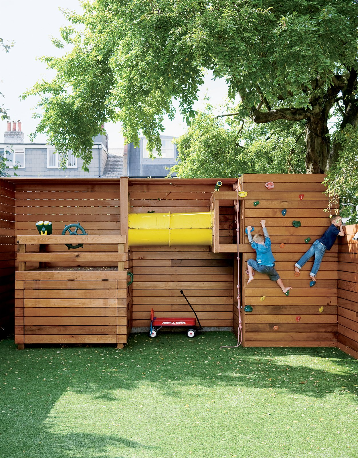 If tidiness is paramount for the family, a place for the kids to play outdoors is equally important. The climbing wall at the back of the garden is entirely the work of Mark Tiarks, who built the Composite House and who relished a chance to step out from beneath Tozer's plans and design an aspect of the house himself. Tagged: Outdoor.  Photo 6 of 10 in Composite Index