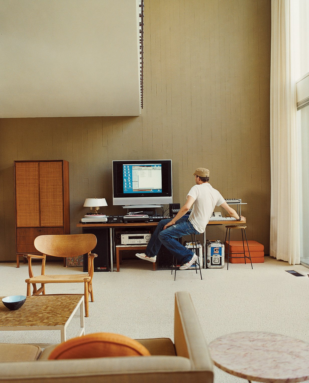 Amidst the vintage furnishings—including pieces by Hans Olsen, Paul McCobb, and Hans Wegner—Stevens works an array of musical gear. Tagged: Office and Desk.  Midcentury Homes by Dwell from Opdahl Remastered