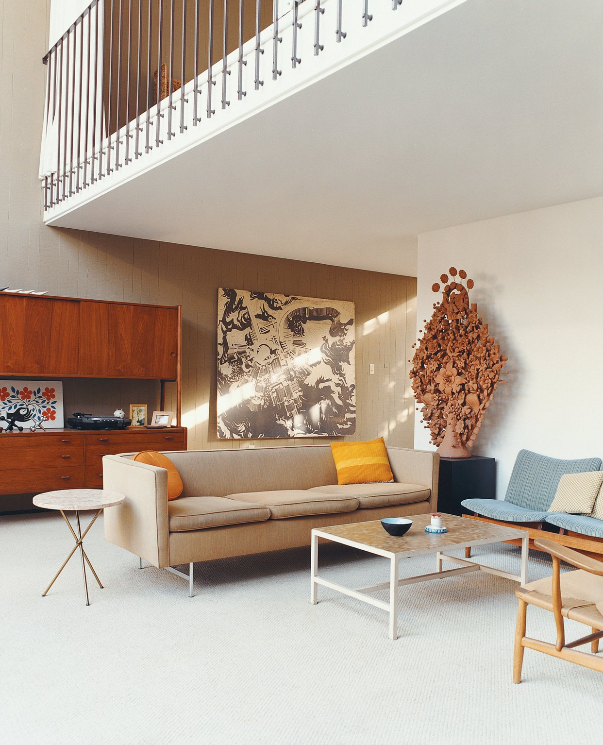 The Wegner CH22 was donated to the home by Joyce and Richard Opdahl. A huge axonometrical rendering by Philo Jacobson hangs in the background. Tagged: Living Room, Coffee Tables, and Sofa.  Midcentury Homes by Dwell from Opdahl Remastered
