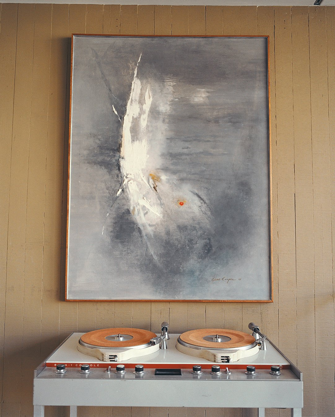 Stevens pared down his collection of vintage furniture and art considerably when he bought the Opdahl house, but he saved critical pieces such as this Gene Cooper painting. Tagged: Living Room.  Photo 8 of 10 in Opdahl Remastered