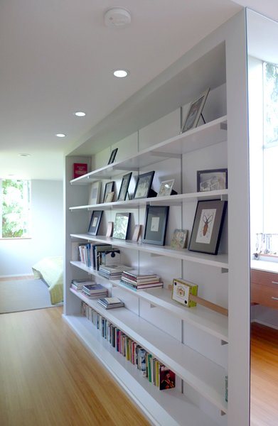 The bookcase delineates the two areas.